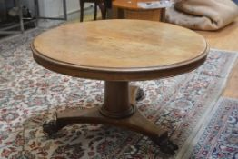 A 19thc mahogany snap top table, the circular top with moulded edge on cut tapered column and tripod