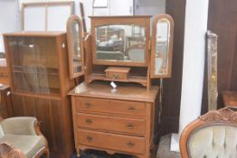 An Edwardian walnut dressing chest with triple adjustable mirror, with centre jewel drawer, above th