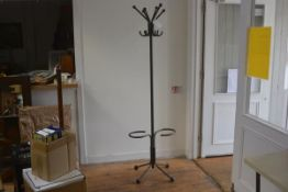 A mid century tubular steel industrial hat and coat stand with six scrolling branches to top and S