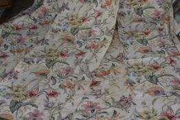 A pair of 1920s/30s printed linen mix curtains with lily and petunia design, cream ground (each
