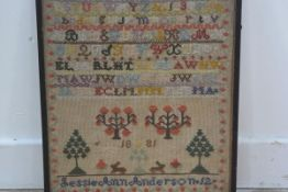 A Victorian sampler by Jessie Ann Anderson aged 12, dated 1885, with alphabet and numbers with