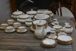 A Royal Doulton Rochelle part dinner and coffee service, no. H5024, with blue and gilt border,