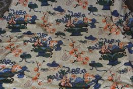A good pair of printed linen curtains, of Chinese inspired design with cloisonne vase of flowers,