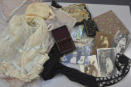 A 1920s child's silk net and lace dress and bonnet complete with rose embroidered voile pyjama case,
