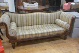 A William IV walnut Regency style scroll end drawing room sofa with inlaid panel back and fluted