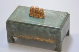 An unusual 1930s bakelite green faux lacquered cigarette box with bracket style feet in the