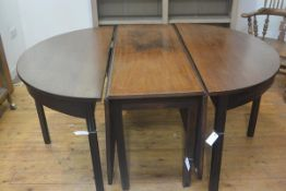 A George III mahogany double D end extending dining table with centre twin drop flaps, with