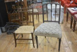 An Edwardian mahogany inlaid bedroom chair with rush seat and a 19thc mahogany spar back chair