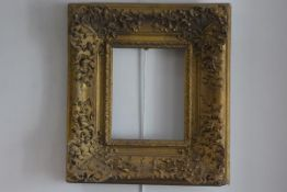 An oak and composition gilt rococco style frame with acanthus leaf and C scroll decoration (aperture