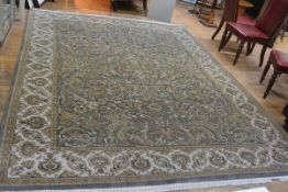 An unusual handmade Shirvan style rug, the centre panel with allover lotus leaf and flower scrolling
