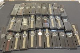 A collection of twenty nine gentleman's quartz sports wristwatches (new and unused) (29)