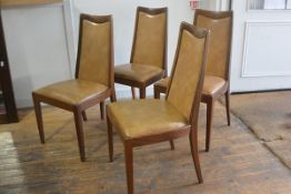 A set of four 1970s teak G Plan panel back and seat dining chairs with original upholstery, raised