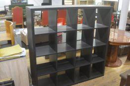 An Ikea black ash cube storage unit, fitted four sections (h. 147cm x l. 107cm x d. 39cm)