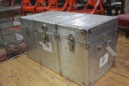 A post war American aluminium travel trunk with studded top, fitted blue lined tray and interior,