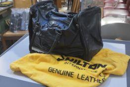 A vintage Shilton International black leather gentleman's holdall complete with cloth bag