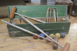 A green painted Jacques style pine croquet box with rope handles to side containing an assortment of