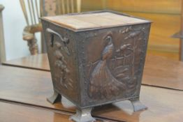 An Arts & Crafts hammered copper and brass mounted two handled coal bucket with embossed stylised