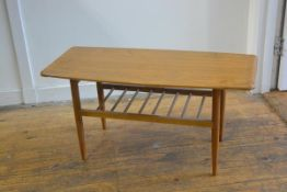 A 1970s formica topped rectangular coffee table, with upswept ends, on turned tapered supports (h.