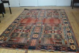 A Louis de Poortere Marco Polo machine made allover design carpet, red ground, complete with