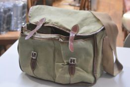 Fishing Interest: a canvas and vinyl trimmed fisherman's bag with waterproof lining, two pockets