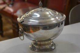 An Epns soup tureen in the Regency style with acorn finial and lion ring mask handles to side (h.