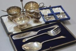 A mixed lot comprising a set of three Edwardian engraved fish servers complete with original box, an