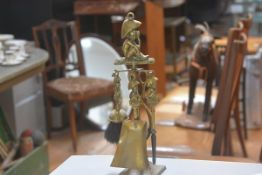 A novelty Dartmoor Pixie cast brass companion set comprising poker, brush, tongs and shovel,