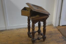 A Victorian oak church offering stand, the square hinged top with circular hole to centre, enclosing