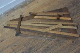 A collection of early 20thc yardsticks (3), a T square, a folding yard stick, a folding measure, a