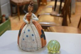 A Spanish terracotta figure in National style costume (h.30cm), a Mdina glass paperweight (2)