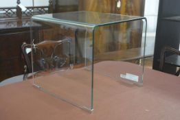 A Habitat toughened glass arched occasional table on chrome tips (h. 41cm x 45cm x 45cm)