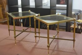 A pair of 1980s brass glazed panel top square lamp tables raised on fluted supports united by
