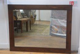 A figured ash rectangular framed overmantel (118cm x 90cm)