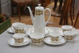 A Royal Tuscan china Arabesque pattern part coffee set, complete with coffee pot, decorated with