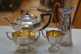 An Epns three piece panelled tea service complete with gilded tiered sugar and cream, and an Epns