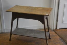 An Edwardian oak Arts & Crafts style occasional table, the rectangular top with moulded edge and
