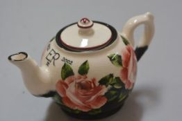 Commemorative ware: A Griselda Hill pottery Wemyss Queen Elizabeth II 50th Anniversary teapot with