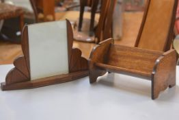 A 1930s mahogany photograph frame with stylised fan shaped twin supports (h.23cm w.37cm) and an