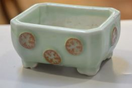 A Celadon ware octagonal bonsai dish decorated with applied brown glazed dragon design, on bracket