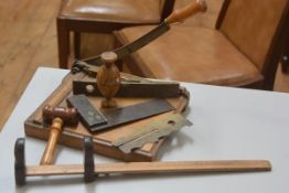 A 1920s treen guillotine, a vintage T square, a brass mounted spirit level by E Preston & Son of