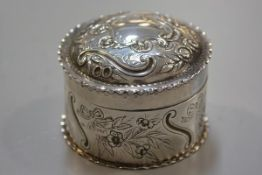 A Victorian London silver circular dish and cover with chased cartouche and C scroll ribbon