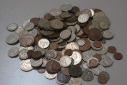A collection of miscellaneous Continental and British coins including silver sixpences, thruppeny