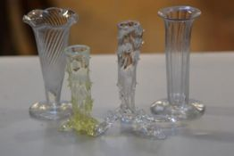 Two 19thc spiral fluted and fluted crystal bud vases, a vaseline glass knob stem bud vase and a