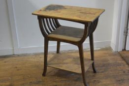 An Edwardian Arts & Crafts pokerwork three tier occasional table, the rectangular top with