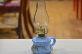 A 19thc blue glass bedchamber oil lamp with handpainted floral design, complete with glass funnel (