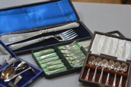A pair of Edwardian Epns fish servers complete with fitted case, two children's pusher sets, a set