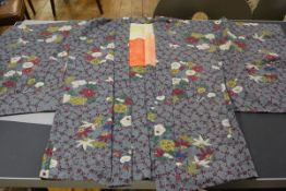 A Japanese short kimono jacket with crysanthemum and prunus floral design in crepe de chine silk (