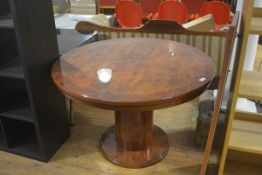 An Italian Connection high gloss walnut veneered and brass inlaid circular extending dining table,