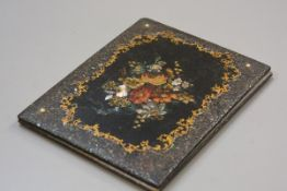 A Victorian papier mache mother of pearl folio cover with handpainted floral decoration enclosed