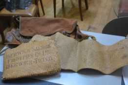 Fishing Interest: a fisherman's brown canvas leather trimmed bag with net to front and canvas